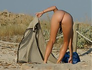 (8 pictures) More pics with tanned body, naked nudists, small tits at at nudist beach