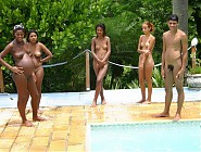 (5 pictures) Naturist pregnant amateurs visiting a nudist pool